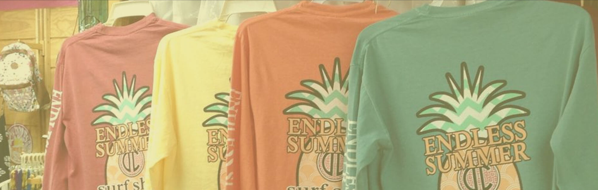 long sleeve shirts hanging on rack with endless summer logo on the back