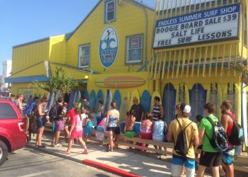people waiting outside the endless summer surf shop
