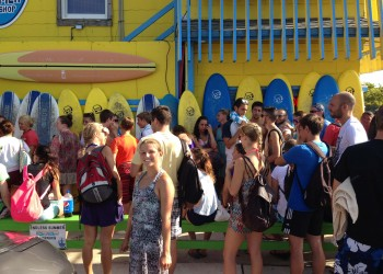 large group waiting outside endless summer surf shop