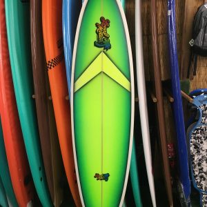 Green tinted local motion surfboard