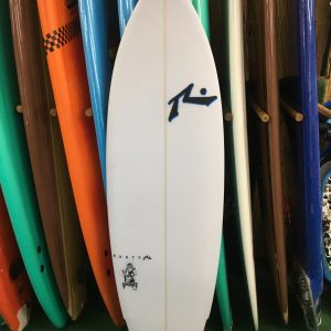 a collection of different colored surfboards