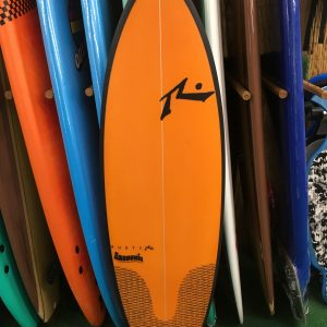 orange and black rusty brand surfboard