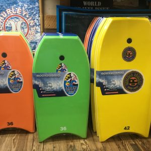 rows of colorful endless summer body boards