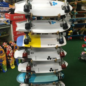 endless summer carver skateboards stacked on shelf