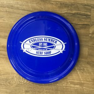 blue frisbee on table with surf shop decal
