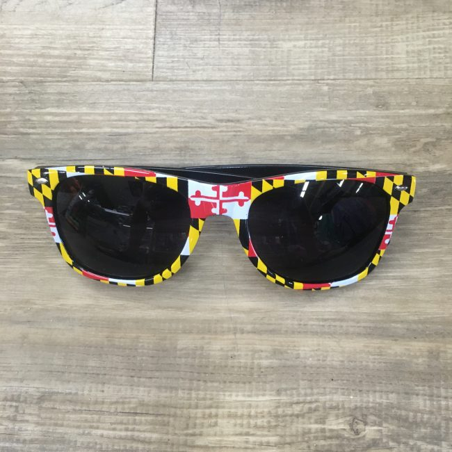 surf wear md flag sunglasses on table