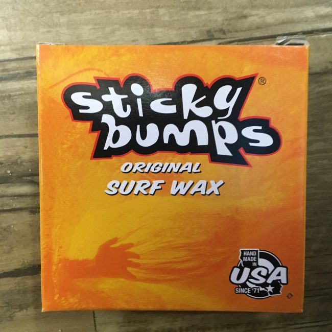 box of sticky bumps surf wax on table