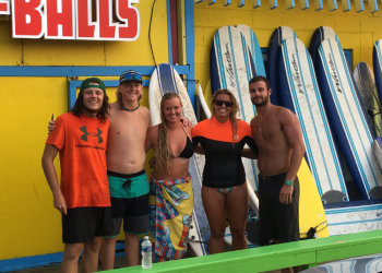 Endless summer surf instructors posing for photo